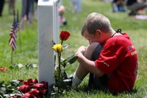 memorial day son at fathers grave